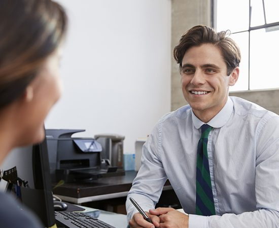 Young male professional in meeting with woman